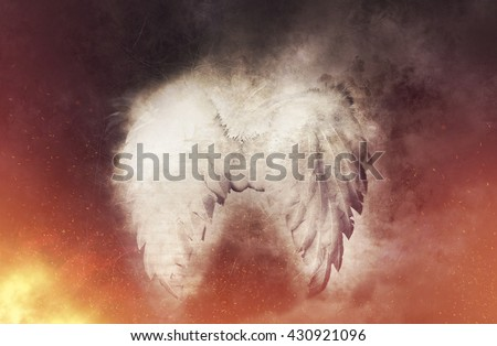 Guardian Angel white wings on the smoky and fire background. Religion and spiritual concept - stock photo