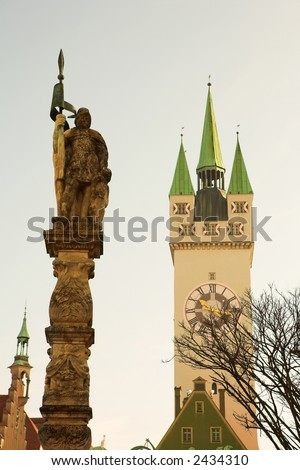 Guardian in front of the Stadtturm in Straubing, Bavaria, Germany