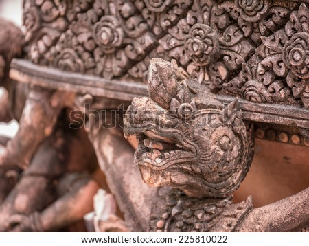 Guardian statue (yak) at the temple Wat phra kaew in the Grand palace area - stock photo