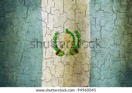 Guatemalan flag on a cracked grunge background - stock photo