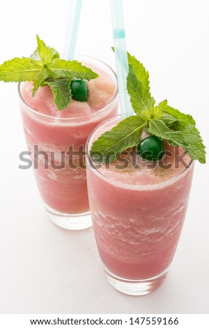 Guava smoothie garnished with green cherry and peppermint. Delicious cold and refreshing drink