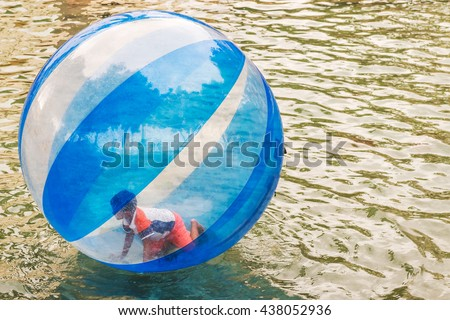 Guayaquil, Ecuador - April 15, 2016: Children playing in the ball and swimming in the pond in the park area in Malecon 2000 in Guayaquil in Ecuador.