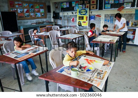 GUAYAQUIL, ECUADOR - FEBRUARY 8: Unknown children in lesson drawing in primary school by project to help deprived children in deprived areas with education, February 8, 2011 in Guayaquil, Ecuador. - stock photo