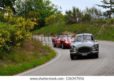 GUBBIO ITALY - MAY 18: Gray 1954 Fiat 8V  driven by John Elkann takes part to the 1000 Miglia 2012, followed by a red 1954 Osca, on May 18, 2012 in Gubbio - stock photo