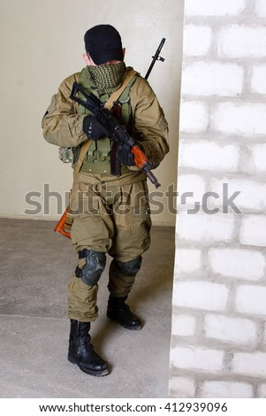 guerillas sniper with sniper rifle inside the building