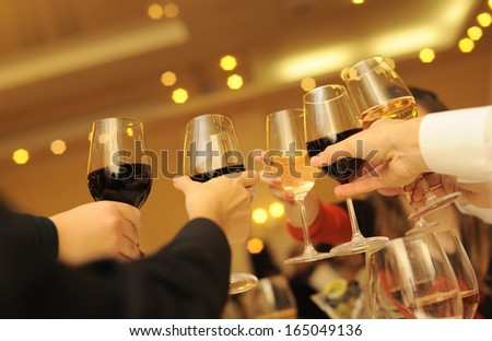 Guests celebration with wine glasses. - stock photo