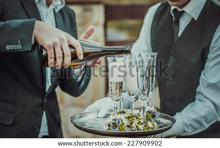 Guests drink champagne on the wedding ceremony outdoor - stock photo