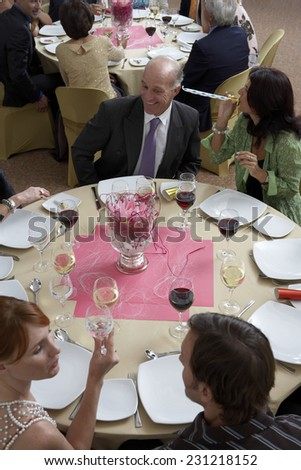 Guests Seated at Tables at Party - stock photo