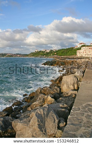 Guethary harbor at sunset, Pays Basque, France. Guethary is located between Bidart and Saint Jean de Luz. - stock photo