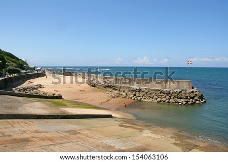 Guethary jetty, Pays Basque, France. Guethary is located between Bidart and Saint Jean de Luz. - stock photo
