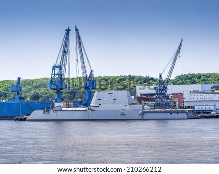 Guided-missile destroyer warship named U.S.S. Zumwalt being built. - stock photo