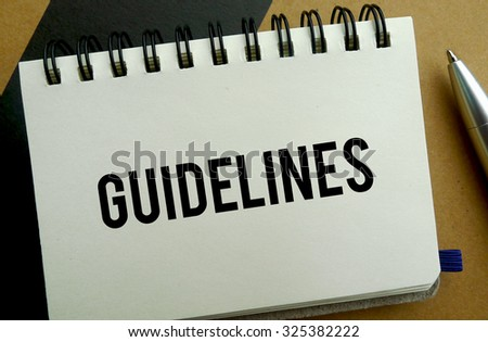Guidelines memo written on a notebook with pen - stock photo