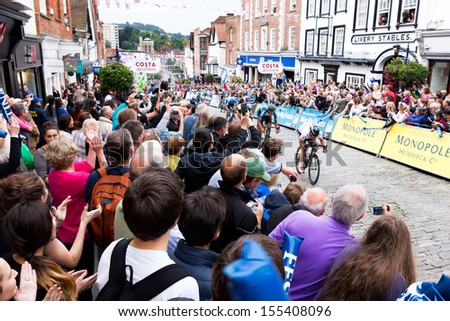 GUILDFORD, UK - SEPT 21: On 21 September 2013, Mark Cavendish won the penultimate stage of the 2013 Tour of Britain.  In this image he is 200m away from the finish and leading the pack. - stock photo