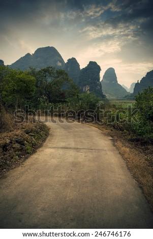 Guilin mountain road - stock photo