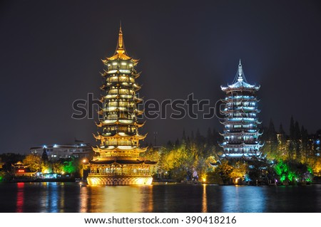 Guilin. Pagodas of Sun and Moon in the lake. - stock photo
