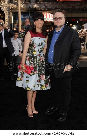 """Guillermo del Toro and Lorenza Newton at the """"Pacific Rim"""" Los Angeles Premiere, Dolby Theater, Hollywood, CA 07-09-13 - stock photo"""