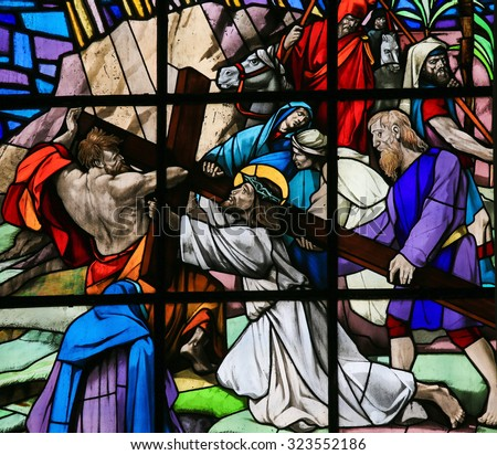 GUIMARAES, PORTUGAL - AUGUST 7, 2014: Stained glass window depicting Jesus on the Via Dolorosa in the Santos Passos church in Guimaraes, Portugal.