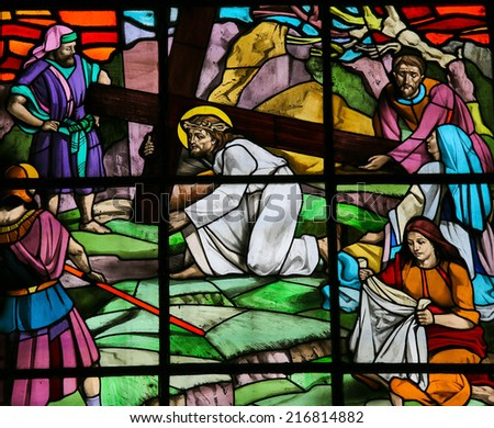 GUIMARAES, PORTUGAL - AUGUST 7, 2014: Stained glass window depicting Jesus on the Via Dolorosa with Veronica and her veil. It is located in the Santos Passos church in Guimaraes, Portugal. - stock photo