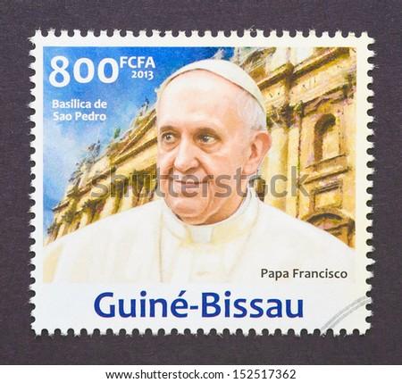 GUINEA-BISSAU - CIRCA 2013: a postage stamp printed in Guinea-Bissau showing an image of pope Francis I, born Jorge Mario Bergoglio, circa 2013.  - stock photo