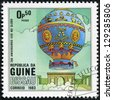 GUINEA-BISSAU - CIRCA 1983: a postage stamp printed in the Republic of Guinea-Bissau commemorative of the 200 anniversary of the first balloon flight, circa 1983. - stock photo