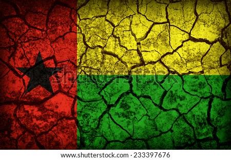 Guinea Bissau flag pattern on the crack soil texture ,retro vintage style - stock photo