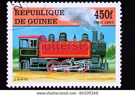 GUINEA - CIRCA 1997:  A stamp printed in Guinea showing an old railroad steam engine manufactured by HK Porter, circa 1997. - stock photo