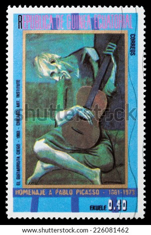 GUINEA - CIRCA 1973: A stamp printed in GUINEA shows a picture of the old guitarist, Pablo Picasso, circa 1973 - stock photo