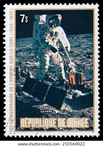 GUINEA - CIRCA 1980: stamp printed by Guinea, shows American astronaut on the moon, circa 1980 - stock photo