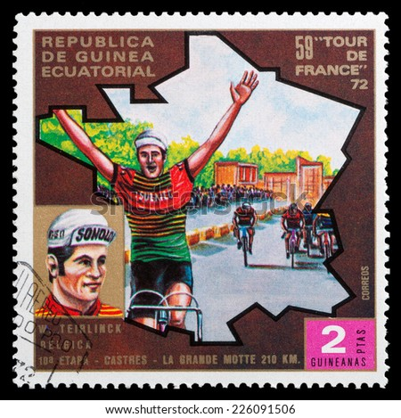 """GUINEA - CIRCA 1972: stamp printed in Guinea shows cyclists and portrait of W. Teirlinck, series """"59 Tour de France, 1972"""", circa 1972 - stock photo"""