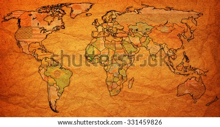guinea flag on old vintage world map with national borders
