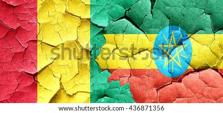 Guinea flag with Ethiopia flag on a grunge cracked wall - stock photo
