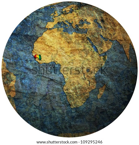 guinea territory with flag on map of globe isolated over white