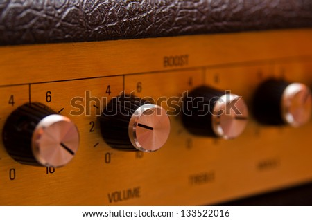 guitar amplifier knobs - stock photo