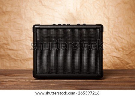 Guitar amplifier on yellow background. - stock photo