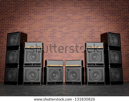 Guitar amps against a brick wall - stock photo
