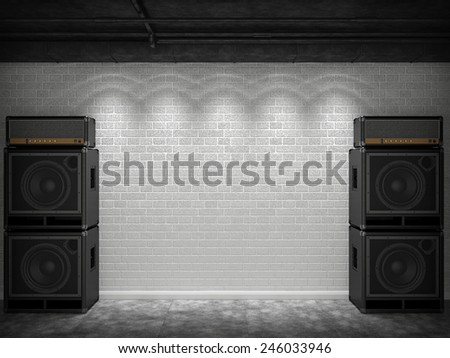 Guitar amps against a white brick wall - stock photo