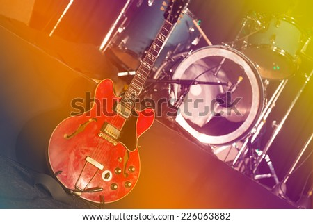 Guitar and drums on stage expect artists before the concert - stock photo