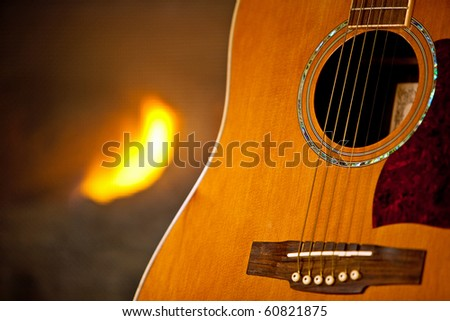 Guitar and fireplace - stock photo