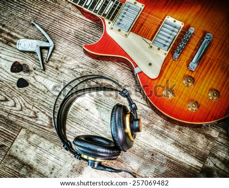 guitar and headphone in hdr tone mapping effect - stock photo