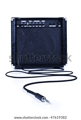 guitar aplifier with cable, focus on plug, white background - stock photo