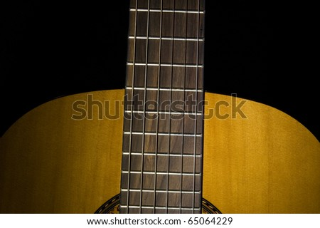 Guitar closeup on black background