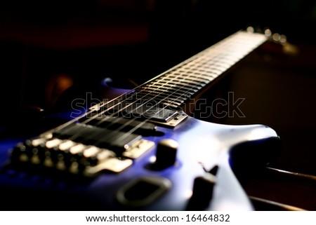 guitar head strings macro on black - stock photo