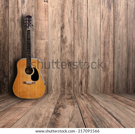 Guitar in old room. - stock photo