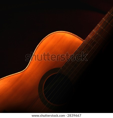 guitar in the dark - stock photo