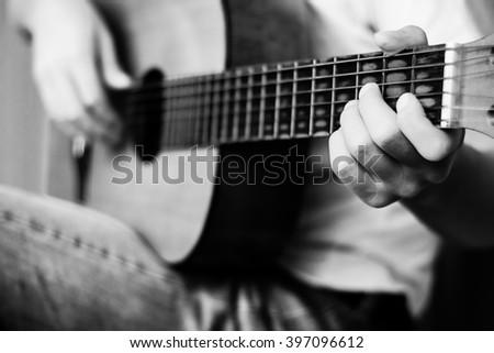 Guitar instrument. Musician or guitarist. Music, musical sound. Finger, hand on string. Acoustic concert closeup. Player play chord. Wood jazz, rock performance. Fret board.  - stock photo