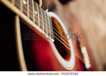 guitar leaning on a old wooden porch - stock photo