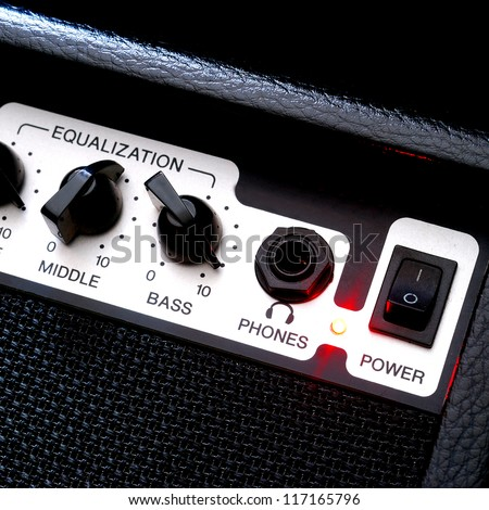 Guitar music amplifier close-up - stock photo
