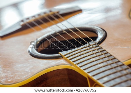 Guitar ,music instrument on wooden background.
