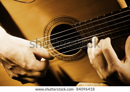 Guitar musical instrument art. String guitarist acoustic playing. Details performer hands vintage retro photo - stock photo