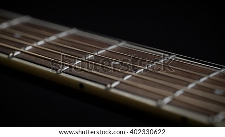 Guitar Neck With Strings Closeup Fretboard